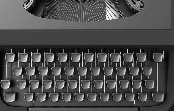 top down photo of a grey typewriter
